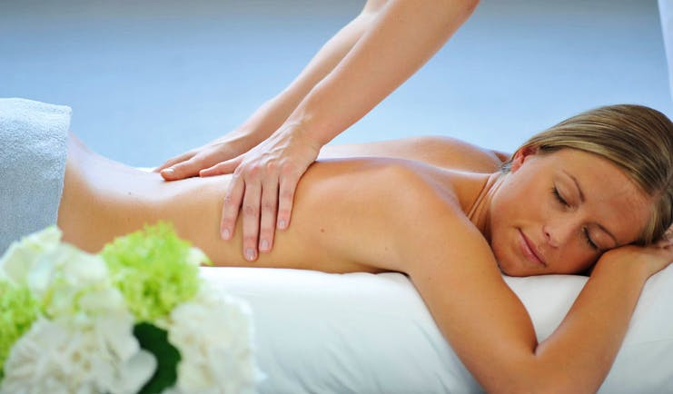 Hotel Royal Alps spa woman receiving a massage