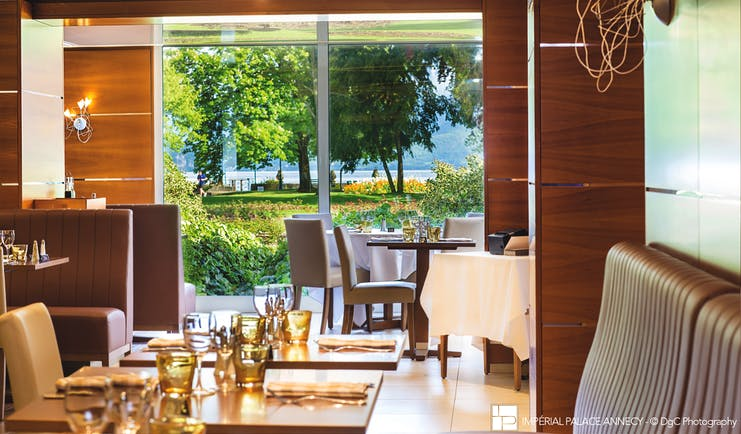 L'Imperial Palace Alps brasserie restaurant with view of trees and lake