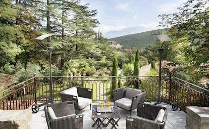 Chateau de Riell terrace with garden views