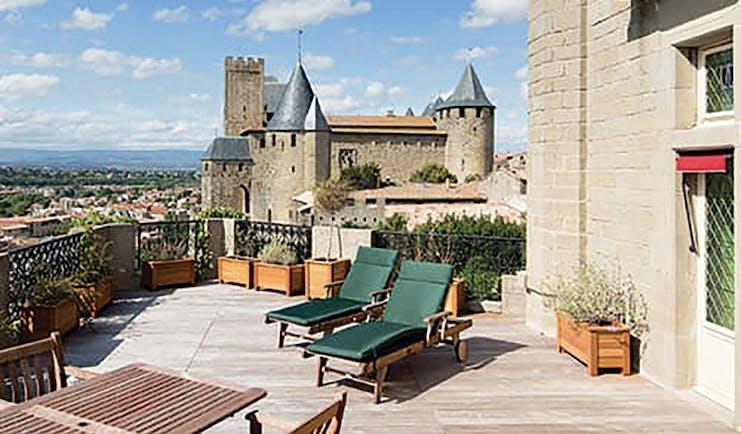 Hotel de la Cite Carcassonne Languedoc Roussillon terrace sun loungers overlooked by a chateau