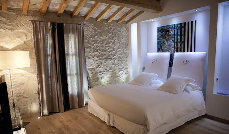 Le Domaine de Verchant Languedoc Roussillon junior suite bedroom with painting behind the bed