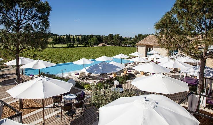 Le Domaine de Verchant Languedoc Roussillon outdoor pool aerial view umbrellas