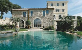 Le Domaine de Verchant Languedoc Roussillon swimming pool large stone building palm trees gardens