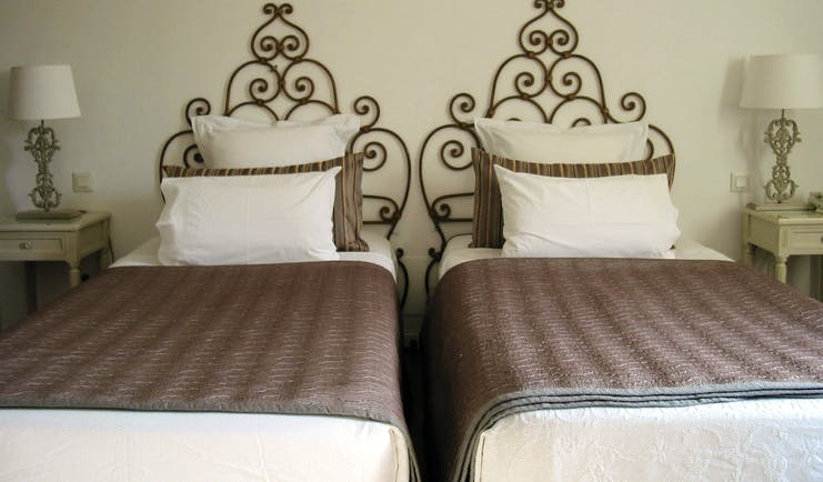 Relais des Chartreuses Languedoc Roussillon room with two beds and wrought iron head boards