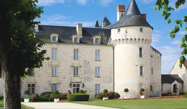 Chateau de Marcay Loire Valley exterior castle large white stone chateau with a turret and grey roof