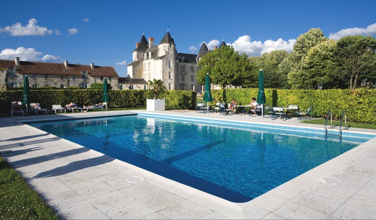 Chateau de Marcay Loire Valley outdoor swimming pool with sun loungers and umbrellas