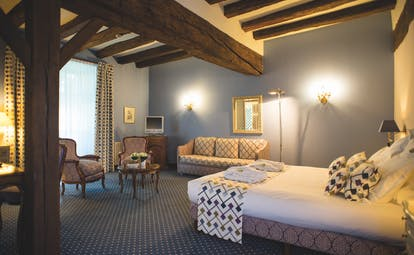 Chateau Noirieux Loire Valley superior king bedroom blue walls and exposed wooden beams