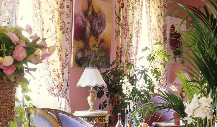 Lounge area with pink and floral patterned colour scheme