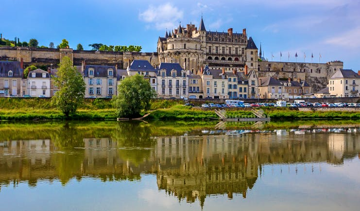 Castle on hill above town overlooking river Loire at Amboise