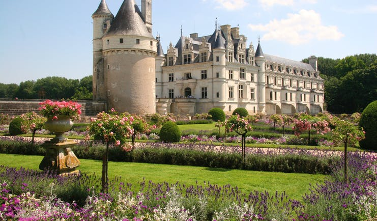 Chateau of Chenonceau with tower and turrets and formal gardens
