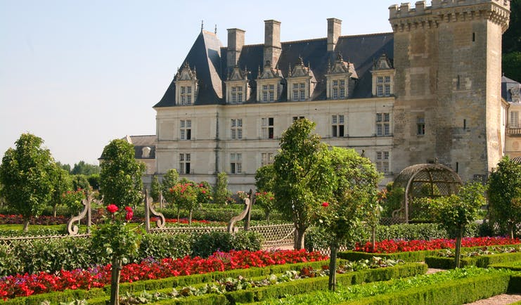 Renaissance chateau with red flowers in bed at Villandy