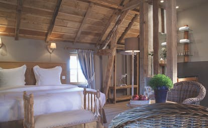 Auberge de la Source Normandy charme superior bedroom wooden roof exposed beams wicker chairs and table