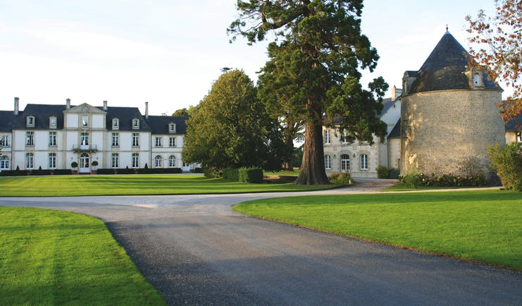 Chateau de Sully ground, hotel buildings, driveway, lawns, trees