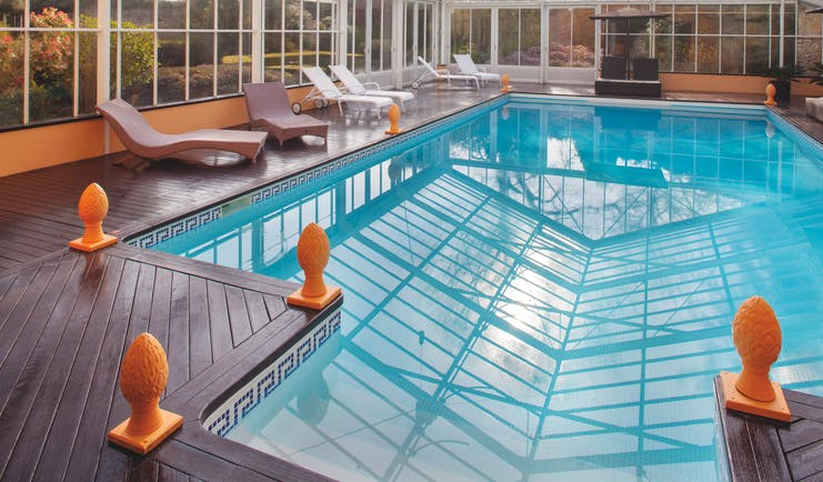 Chateau de Sully pool, indoor pool, glass walls and ceiling, sun loungers