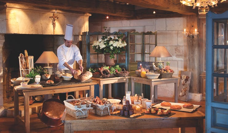 La Ferme Saint Simeon Normandy buffet breakfast bench two large tables with bread and pastries