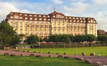 Hotel Royal Barriere exterior, large building, lawns, grand architecture