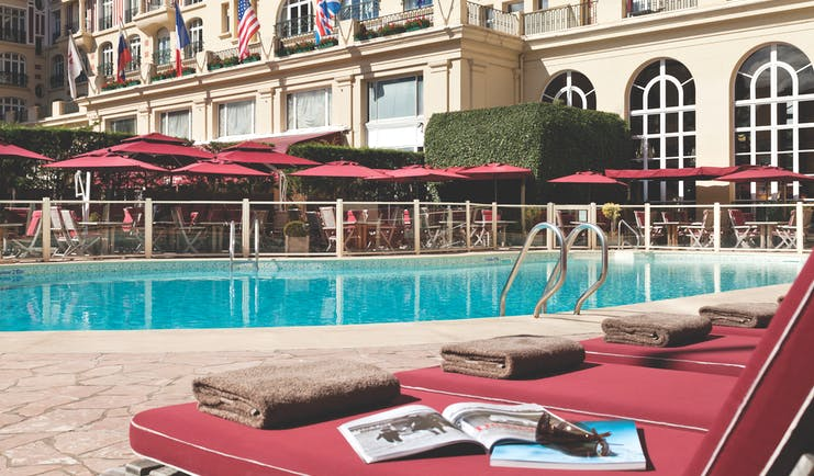 Hotel Royal Barriere pool, sun loungers, umbrellas, hotel building in background