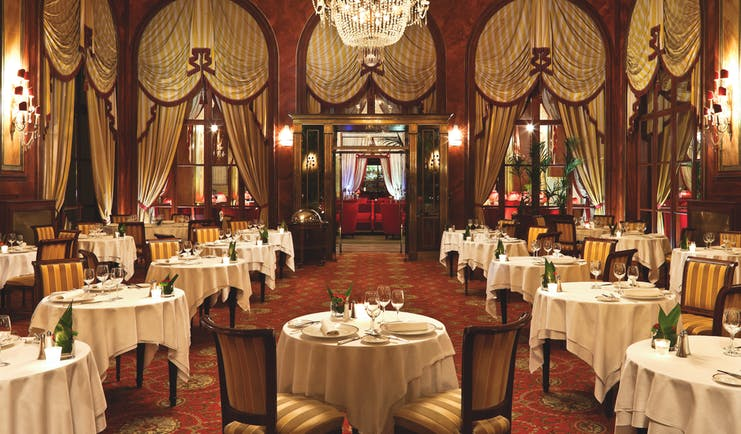 Hotel Royal Barriere restaurant, traditional decor, tables chairs, drapery, chandelier