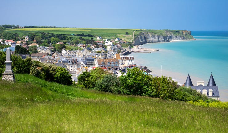 Coastal town of Arromanches with sea and harbour in Normandy