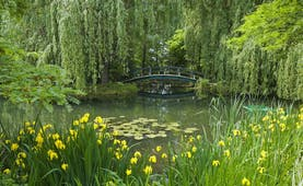 Bridge and water with flowers and greenery in Monet's garden in Giverny