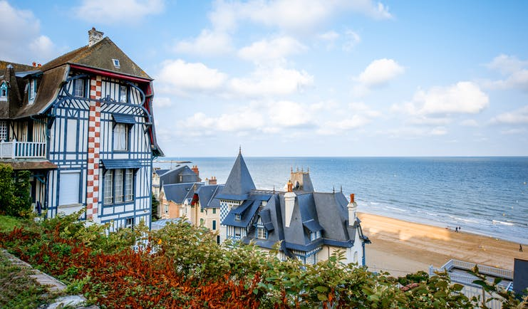 Chateau-style houses with turrets in Normandy coastal town of Trouville