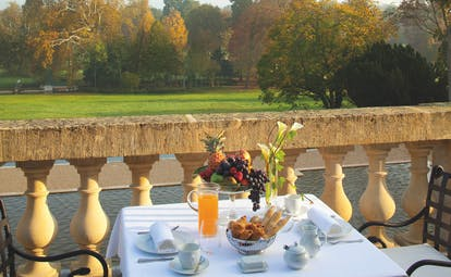 Auberge du Jeu de Paume Paris balcony terrace table fruit and pastries lawn view