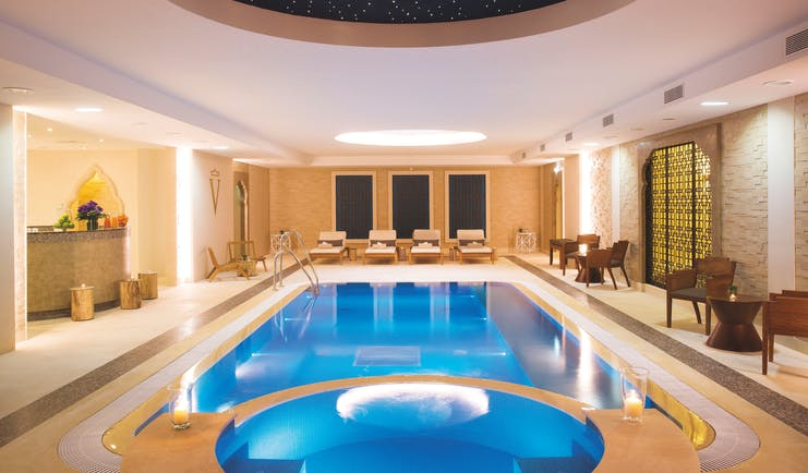 Auberge du Jeu de Paume Paris indoor pool with loungers and a dark blue domed ceiling