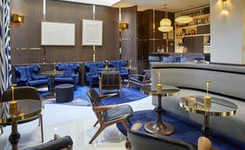 Hotel Bel Ami Paris blue charis and chrome in a wooden lined bar