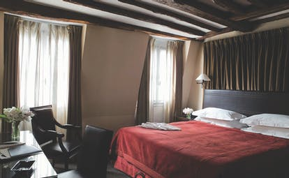 Hotel Esprit Saint Germain Paris deluxe bedroom with dark wooden desk and chair