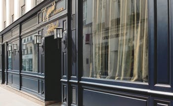 Hotel Esprit Saint Germain Paris entrance dark fronted hotel with a sign reading 'Esprit Saint Germain'