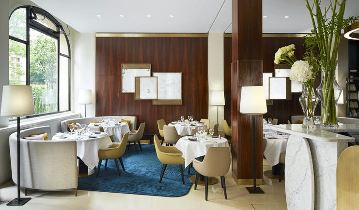 Hotel Montalembert restaurant with white chairs and blue rug