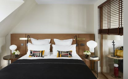 Hotel Montalembert bedroom with shutters and sloping room