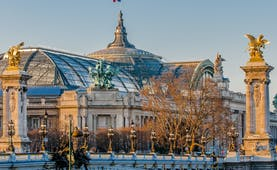 Grand palais Paris with flag on roof and bridge with columns Paris