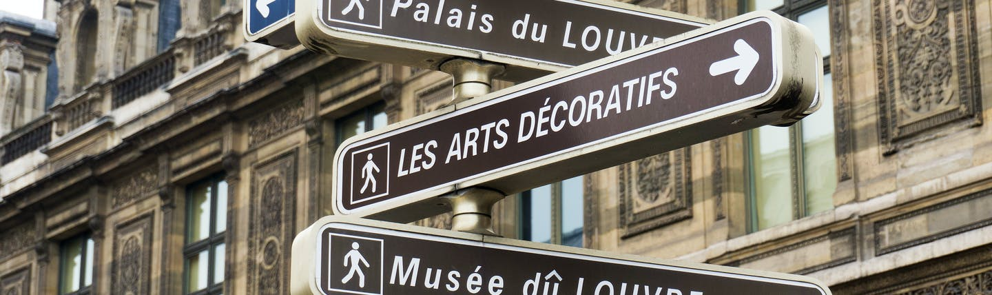 Direction signs for tourists of sites in Paris