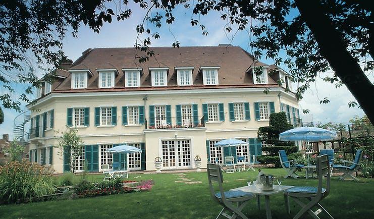 Chateau de Montreuil Pas de Calais exterior white building with blue shutters and gardens