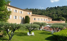 Bastide du Calalou Provence gardens yellow building with shutters overlooking gardens and outdoor dining area