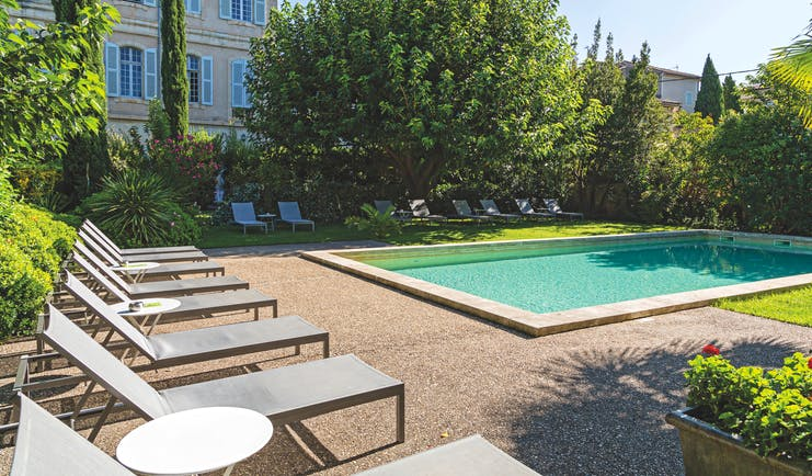 Chateau de Mazan Provence outdoor swimming pool surrounded by trees and sun loungers