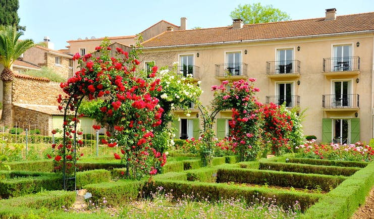Chateau de Valmer exterior of house with roses and flower beds