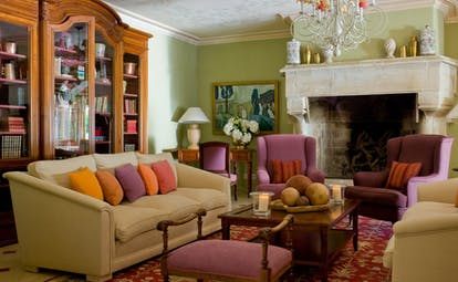 Chateau de Valmer comforable sofas and bright cushions in lounge