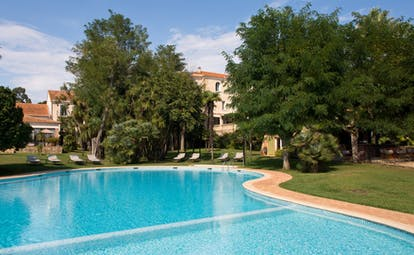 Chateau de Valmer blue water of freeform swimming pool