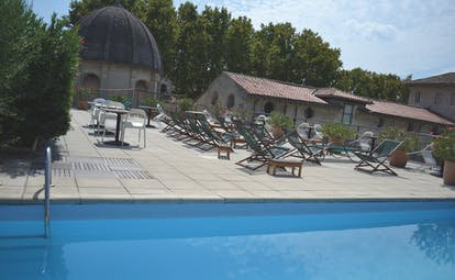 Le Cloitre Saint Louis Avignon rooftop pool with wooden and green sun loungers