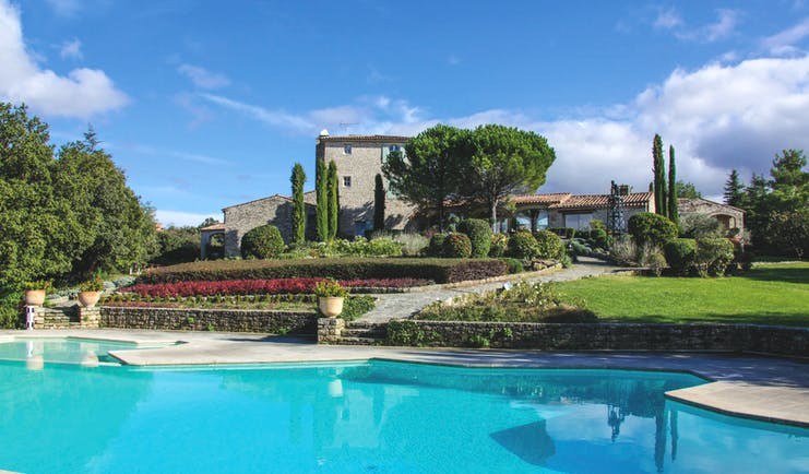 Domaine de Capelongue Provence exterior swimming pool stone building and trees