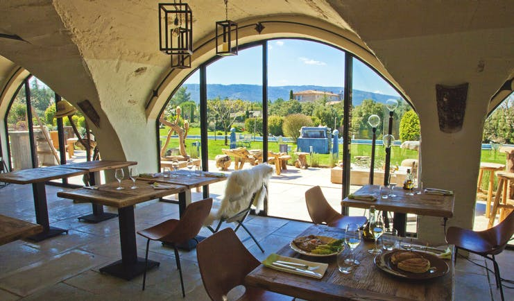 Domaine de Capelongue Provence restaurant dining area with large windows overlooking the countryside
