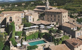 Hotel Crillon le Brave Provence aerial village view several buildings and an outdoor swimming pool