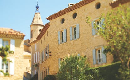 Hotel Crillon le Brave Provence exterior building yellow stone building round windows and shutters