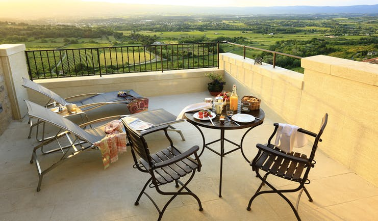 Hotel Crillon le Brave Provence patio terrace with sun loungers table with fruit and pastries