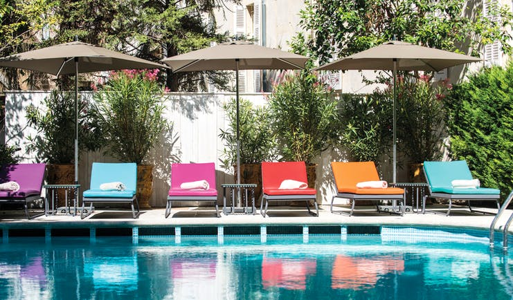 Hotel Jules Cesar Provence outdoor pool loungers and umbrellas