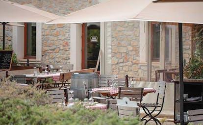 Chateau de Berne Provence bistro patio outdoor dining area umbrellas