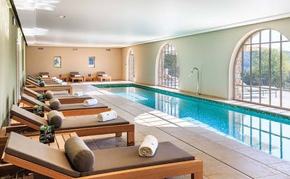 Chateau de Berne Provence indoor spa pool with wooden loungers