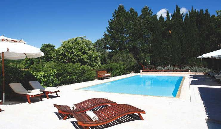 La Bastide de Moustiers Provence outdoor pool with two wooden sun loungers